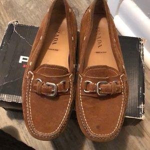 Prada loafers.